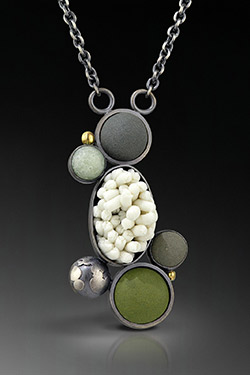Schwegmann Necklace on black gradient background