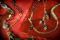 Jewelry on red silk background