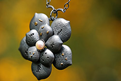 Bayne Pendant Necklace on a fall foliage background